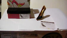 Maneater.  In black and gold.  Raine just the right shoe miniature collectible