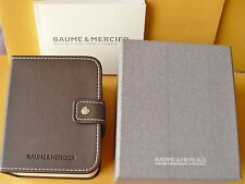 Baume and Mercier watch display box complete with instructions and warranty.