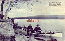 RETURN FROM THE CHASE CHATEAUGAY LAKE ADIRONDACKS NY men in canoe with deer 1907