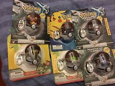Pokemon   Pikachu figure   poke ball keychain and six other  poke ball figures