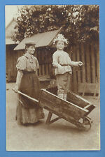*WOMAN PUSHING WHEELBARROW WITH CHILD IN IT VINTAGE PHOTO PC  B 1100