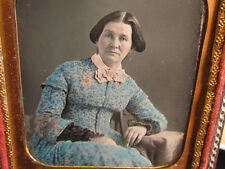 victorian woman with blue colored dress daguerreotype photograph