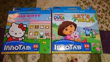 Lot 2 VTECH INNOTAB GAME CARTRIDGES Dora Lets Help & Hello Kitty A day with HK