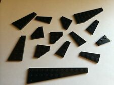 lot of 14 assorted size black Lego plates - assorted small wings