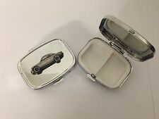 Ginetta G15 ref88 pewter effect car emblem on a silver metal pill box