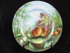 CREIL ET MONTEREAU-ANCIEN GRAND PLAT PEINT AU DECOR DE NATURE MORTE AUX FRUITS