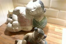 UNIQUE AND VERY RARE PAIR OF HAND PAINTED RECLINING BUDDHA CHILDREN