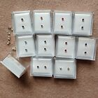 JOB LOT-10 pairs of 10 different colours diamonte stud earrings. Gift boxed.