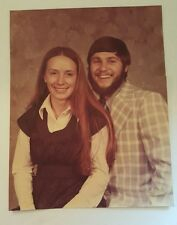 Vintage photograph of Husband and wife  posing for photo studio 1970's