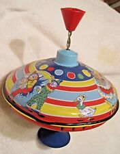 "Schylling Silly Circus Tin Top Press and spin  good condition no box 6 1/2"" dia"