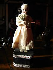 "Reproduction of an antique automaton clockwork doll with music box 15"" tall"