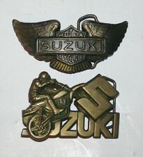 PAIR OF VINTAGE SUZUKI MOTORCYCLE BRASS BELT BUCKLES OLD LOGO WING & BARON 1980