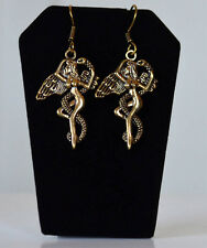 Base metal gold tone Angles Dangle Earrings Handmade fashion Jewelry India