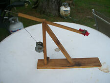 Vintage primitive fishing tip up with Shakespeare 1958 Triumph model HE reel