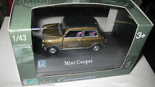 CARARAMA  MINI COOPER GOLD WITH BLACK ROOF OPENING DOORS  1/43 DIECAST