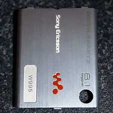 GENUINE SONY ERICSSON W995 SILVER BATTERY / BACK COVER