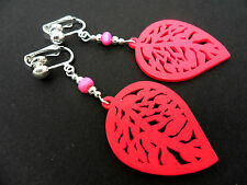 A PAIR OF LOVELY PINK WOODEN DANGLY LEAF CLIP ON EARRINGS. NEW.