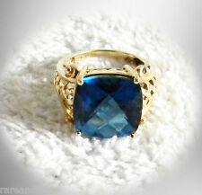 Blue stone fantasy ring with 14K gold band - size 7