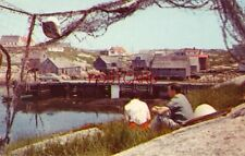 couple sits on shore at FAMOUS BEAUTY SPOT OF PEGGY'S COVE, NOVA SCOTIA CANADA
