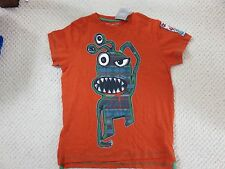 Next Boys t shirt. Orange with monster logo Age 9 Yrs. New with tags.