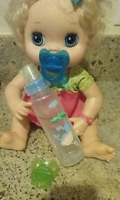 2 PACIFIERS AND BABY BOTTLE FOR BABY ALIVE DOLLS .   NO DOLL INCLUDED !