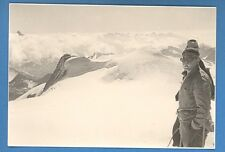 SNOW ON THE MOUNTAIN, CLIMBER AT THE TOP OF THE MOUNTAIN PHOTO 4865