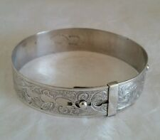 Sterling silver buckle bangle, foliate motifs.  By Henry Griffith & Sons Ltd.