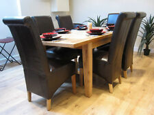 Extending Solid Oak Dining Table And Six Black Leather Chairs Dining Set