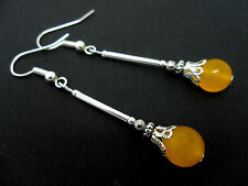 A PAIR OF YELLOW JADE BEAD  SILVER PLATED DANGLY  EARRINGS. NEW.