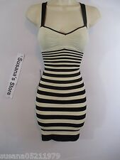 nwb BEBE PADDED STRIPE BODYCON DRESS SZ M/L Bold up your after-hours look with t