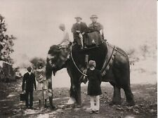 POST CARD OF VINTAGE PHOTOGRAPH OF A COUPLE TRAVELING IN INDIA ON AN ELEPHANT