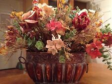 metal planter with silk floral arrangement