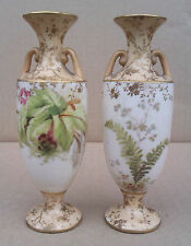 PAIR OF DOULTON BURSLEM MINIATURE TWO HANDLED VASES.