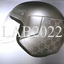 GUCCI TOM FORD SILVER BOOK MOTO HELMET THAT GWYNETH TOOLS  AROUND LONDON