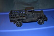 Old vintage antique cast iron black truck with open sided bed