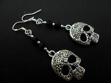 A PAIR DANGLY SKULL THEMED EARRINGS WITH 925 SOLID SILVER HOOKS. NEW..