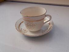 ? VINTAGE BREAKFAST CUP AND SAUCER  WITH A GOLD COLOURED LEAF PATTERN   NO MAKER