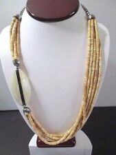 VINTAGE NECKLACE 1980S GYSPY BOHO HEISHE BEADS BRASS AND SEAL PENDANT IN LUCITE