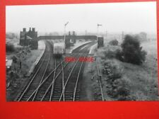 PHOTO  HELSBY RAILWAY STATION DMU APPROACHING
