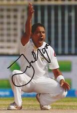 PAKISTAN: ZULFIQAR BABAR SIGNED 6x4 TEST ACTION PHOTO+COA