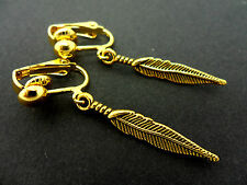 A PAIR OF  PRETTY GOLD COLOUR DANGLY SLIM  FEATHER/LEAF  CLIP ON EARRINGS. NEW.