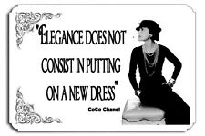 Elegance does not consist in putting on a new dress  CoCo Chanel Couture  SIGN