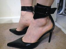 spiky stiletto dominatrix ankle strap buckle bondage fetish black leather heels