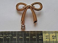 VINTAGE BOWTIE WITH RHINESTONE GOLD TONE METAL COSTUME LAPEL BROOCH PIN