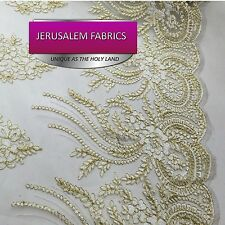 Dazzling embroider gold and white flower lace fabric. Sold by the yard.