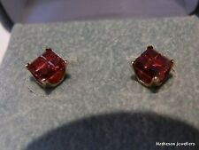 Square. 5x5mm Garnet, 4 stones in each invisible setting, 10k Y Stud earrings