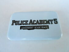 VINTAGE PINBACK BUTTON #81- 057 - MOVIE -POLICE ACADEMY 5 ASSIGNMENT MIAMI BEACH