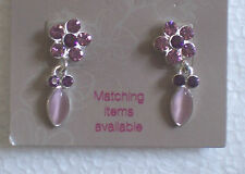 Pink diamante flower and cats eye clip-on earrings