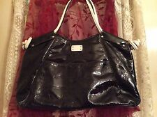 LARGE BLACK TOTE WITH TWO HANDLES BY NEW DIRECTIONS.