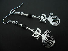 A PAIR OF TIBETAN SILVER  AND BLACK  BEAD CAT  EARRINGS. NEW.